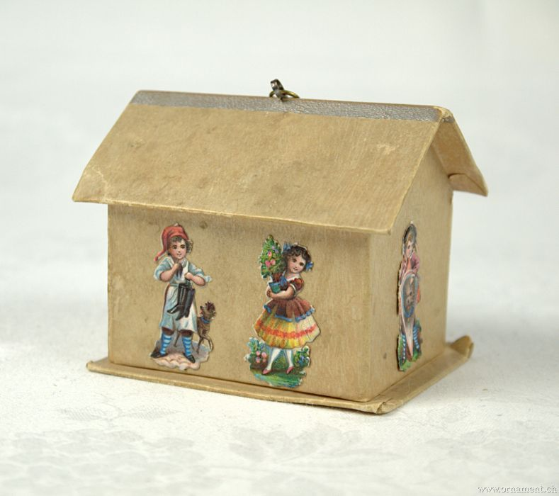 House with scrap figures