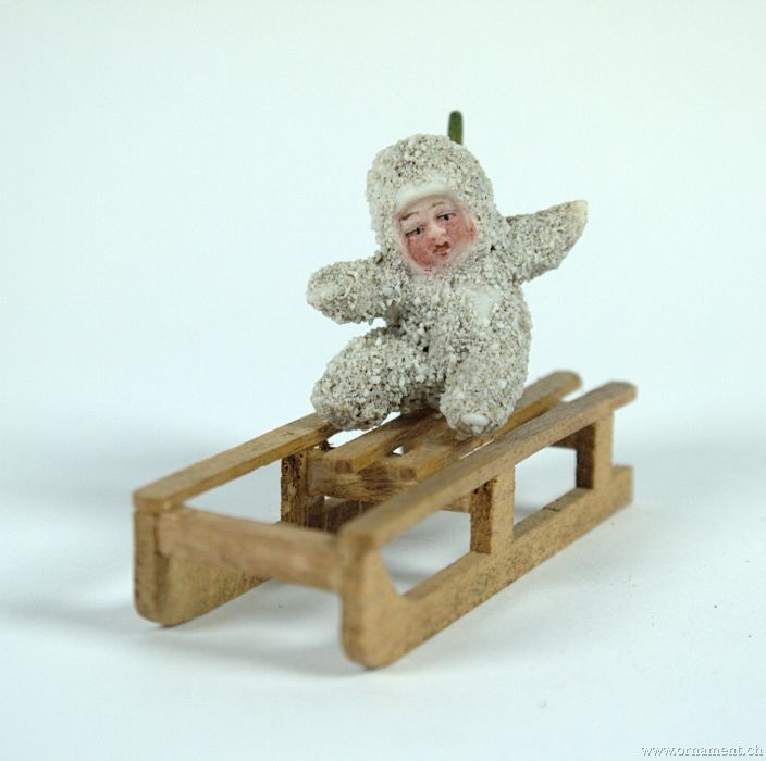 Snow Baby on Sleigh with Fir Tree